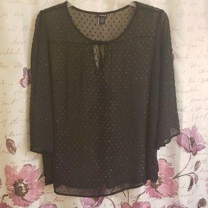 Black sheer blouse.